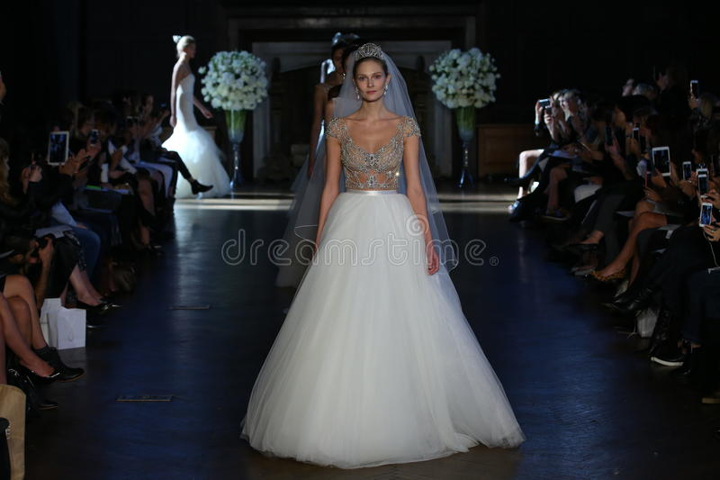 Models walk the runway during the Alon Livne White Fall/Winter 2016 Couture Bridal Collection. NEW YORK, NY - OCTOBER 10: Models walk the runway during the Alon royalty free stock photos