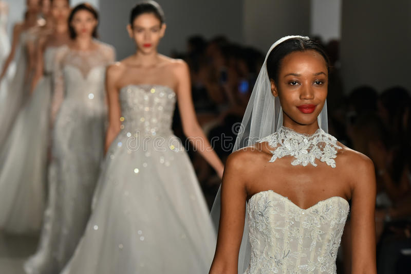 Models walk the runway during the Amsale Fall/Winter 2016 Couture Bridal Collection runway show. NEW YORK, NY - OCTOBER 09: Models walk the runway during the royalty free stock photos