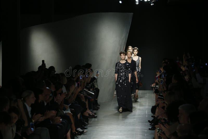 Models walk the runway during Bottega Veneta show as a part of Milan Fashion Week. MILAN, ITALY - SEPTEMBER 20: Models walk the runway during Bottega Veneta show stock images