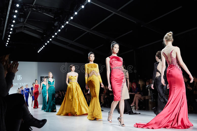 Models walk runway in Dany Tabet dress at the New York Life fashion show during MBFW Fall 2015 royalty free stock photos