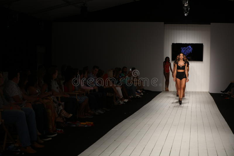 Models walk runway in designer swim apparel during the Furne Amato fashion show. MIAMI, FL - JULY 16: Models walk runway in designer swim apparel during the royalty free stock photos