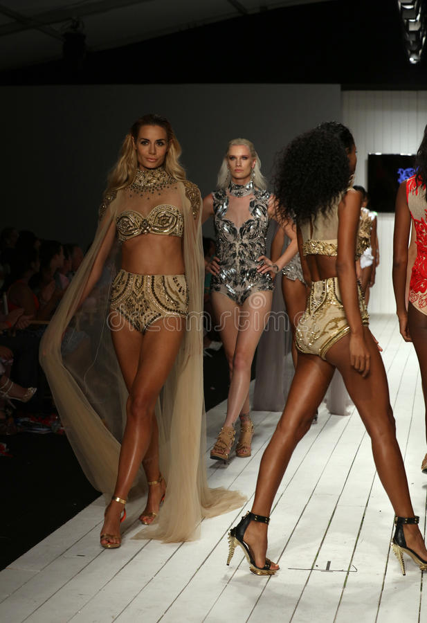 Models walk runway in designer swim apparel during the Furne Amato fashion show. MIAMI, FL - JULY 16: Models walk runway in designer swim apparel during the stock photography