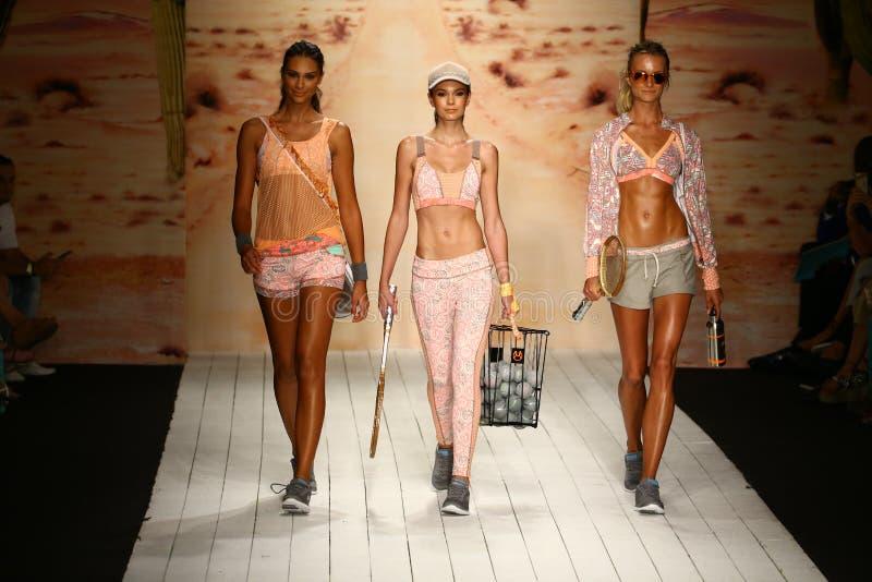 Models walk runway in designer swim apparel during the Maaji Swimwear fashion show. MIAMI, FL - JULY 19: Models walk runway in designer swim apparel during the stock photo