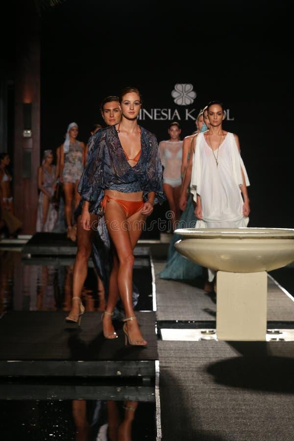 Models walk runway finale in designers swim apparel for the Sinesia Karol fashion presentation. MIAMI, FL - JULY 17: Models walk runway finale in designers swim stock photography