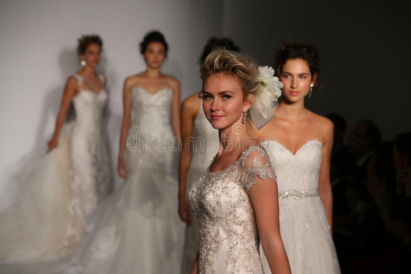 Models walk the runway finale during the Maggie Sotero Fall/Winter 2016 Couture Bridal Collection runway show. NEW YORK, NY - OCTOBER 10: Models walk the runway royalty free stock images
