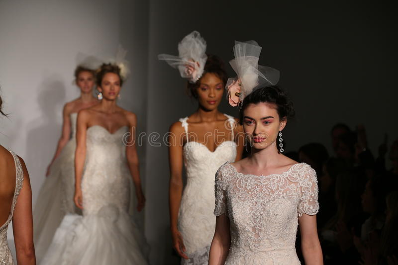 Models walk the runway finale during the Maggie Sotero Fall/Winter 2016 Couture Bridal Collection runway show. NEW YORK, NY - OCTOBER 10: Models walk the runway stock photo