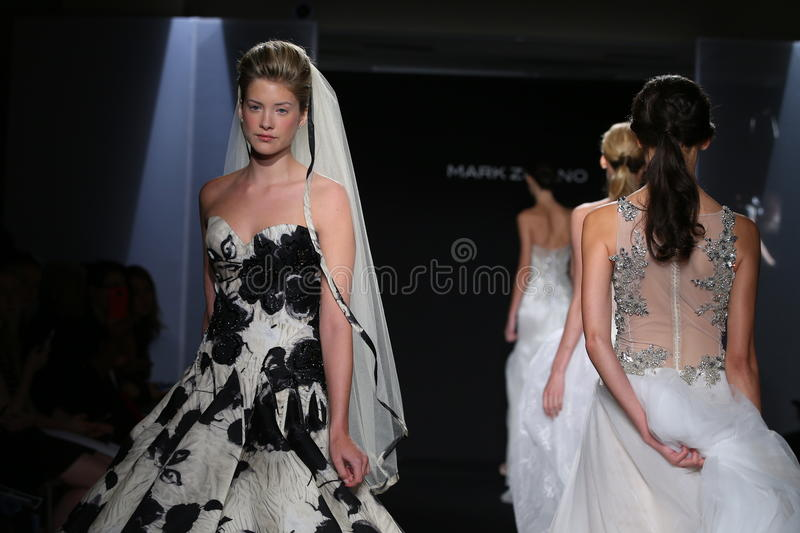 Models walk the runway during the Mark Zunino Fall/Winter 2016 Couture Bridal Collection. NEW YORK, NY - OCTOBER 13: Models walk the runway during the Mark stock images