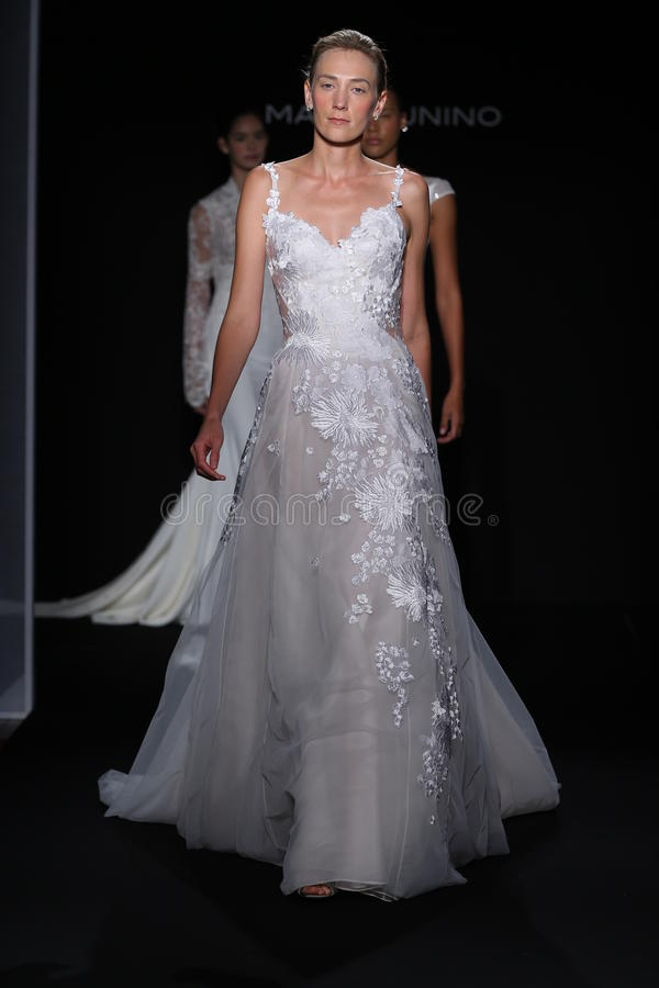 Models walk the runway during the Mark Zunino Fall/Winter 2016 Couture Bridal Collection. NEW YORK, NY - OCTOBER 13: Models walk the runway during the Mark stock photography