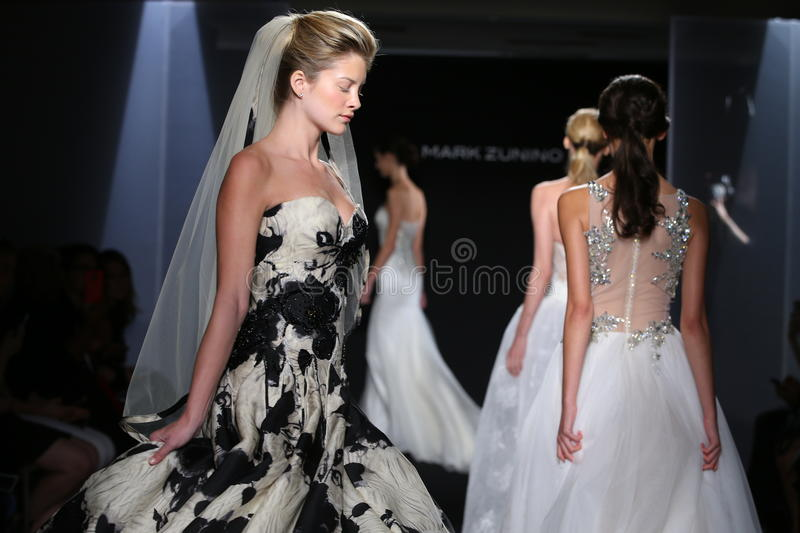 Models walk the runway during the Mark Zunino Fall/Winter 2016 Couture Bridal Collection. NEW YORK, NY - OCTOBER 13: Models walk the runway during the Mark stock photos