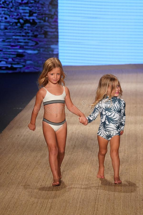Models walk the runway for MIKOH Resort 2019 Runway Show. MIAMI BEACH, FL - JULY 13: Models walk the runway for MIKOH Resort 2019 Runway Show at The Paraiso Tent royalty free stock image