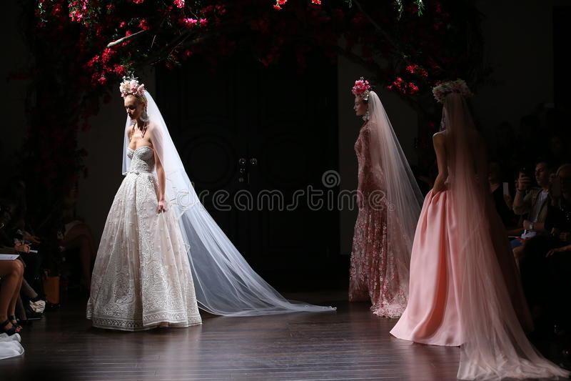 Models walk the runway during the Naeem Khan Fall/Winter 2016 Couture Bridal Collection runway show. NEW YORK, NY - OCTOBER 09: Models walk the runway during the royalty free stock images