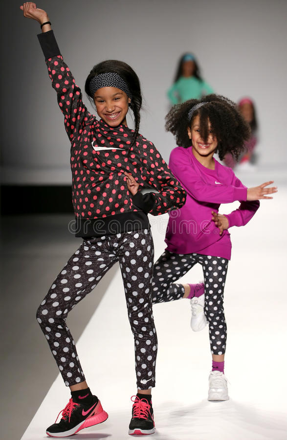 Models walk the runway at the Nike Levi's Kids fashion show during Mercedes-Benz Fashion Week Fall 2015. NEW YORK, NY - FEBRUARY 12: Models walk the runway at royalty free stock photos