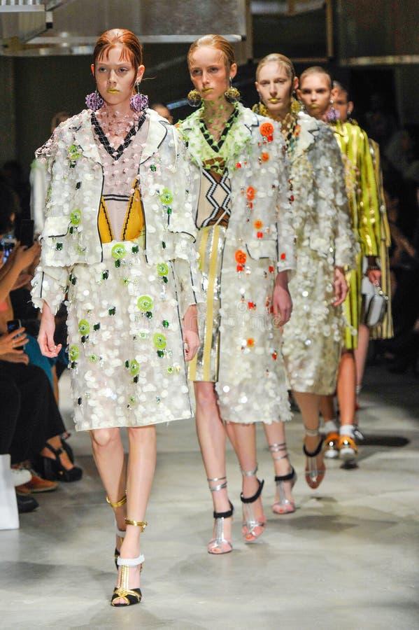 Models walk the runway during the Prada fashion show royalty free stock photo