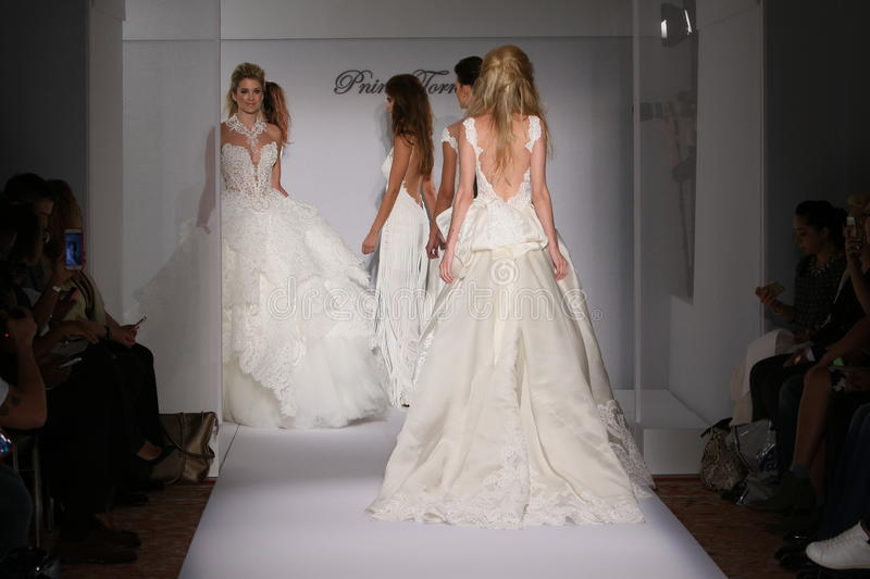Models walk the runway during the Prina Tornai Fall/Winter 2016 Couture Bridal Collection. NEW YORK, NY - OCTOBER 12: Models walk the runway during the Prina stock photo