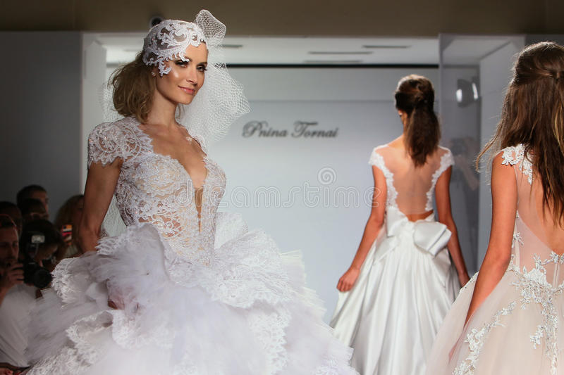 Models walk the runway during the Prina Tornai Fall/Winter 2016 Couture Bridal Collection. NEW YORK, NY - OCTOBER 12: Models walk the runway during the Prina royalty free stock photo