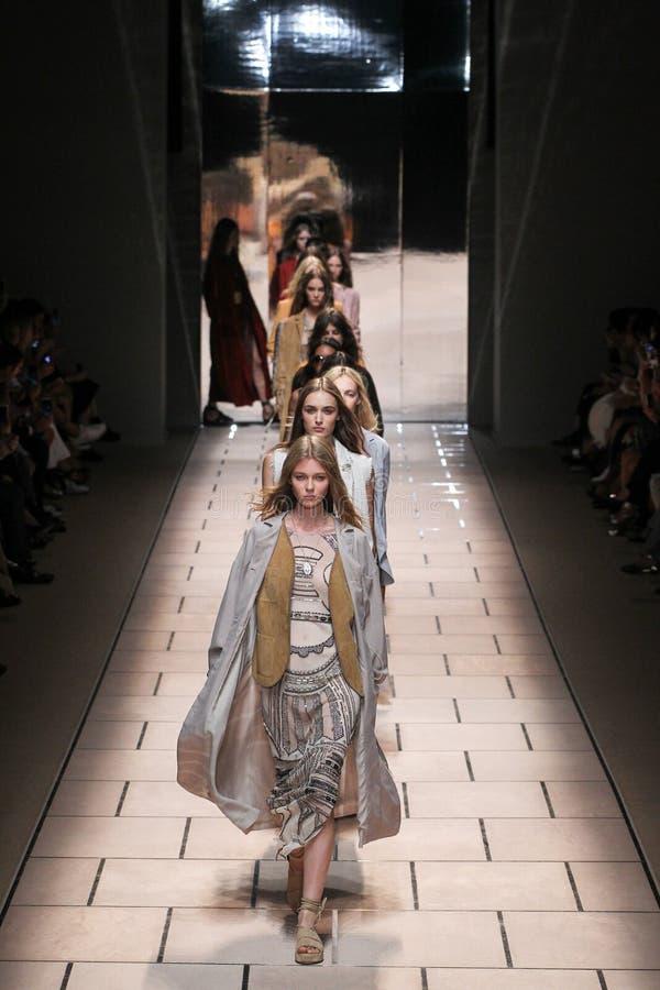Models walk the runway during the Trussardi show. MILAN, ITALY - SEPTEMBER 27: Models walk the runway during the Trussardi show as a part of Milan Fashion Week royalty free stock photos