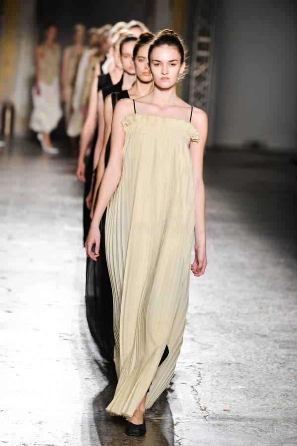 Models walk the runway during the Uma Wang fashion show. MILAN, ITALY - SEPTEMBER 25: Models walk the runway during the Uma Wang fashion show as part of Milan stock photos