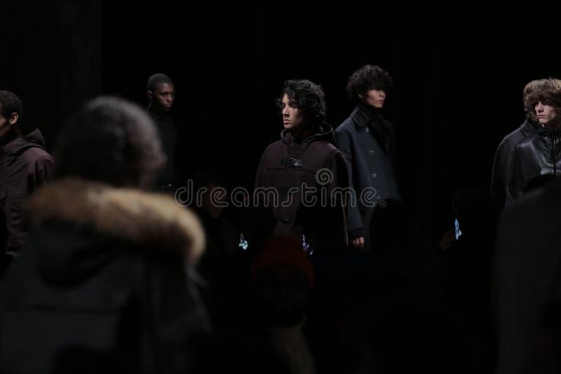 Models walk the ruway finale at the Boss fashion show. NEW YORK, NY - JANUARY 31: Models walk the ruway finale at the Boss fashion show during NYFW: Mens at royalty free stock photos