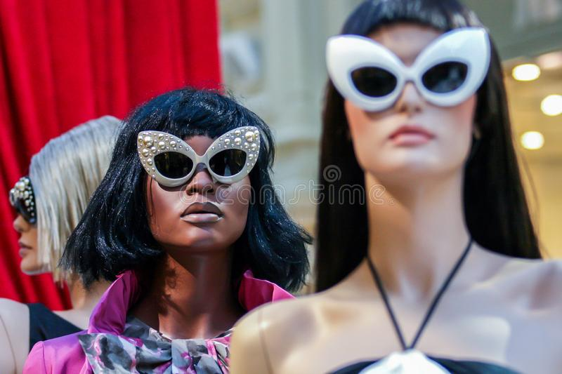 Models of woman sunglasses in the store. Summer fashion. stock photos