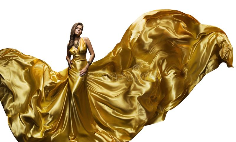Modemodell Golden Fly Dress, elegant kvinna som fladdrar kappan royaltyfri bild