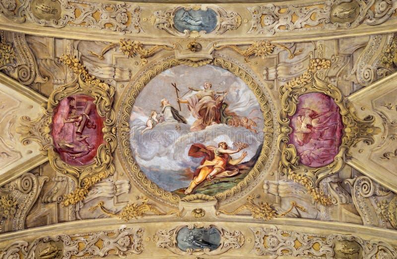 MODENA, ITALIA - 14 APRILE 2018: L'affresco barrocco del soffitto con la st Barbara in chiesa Chiesa di San Barnaba fotografia stock