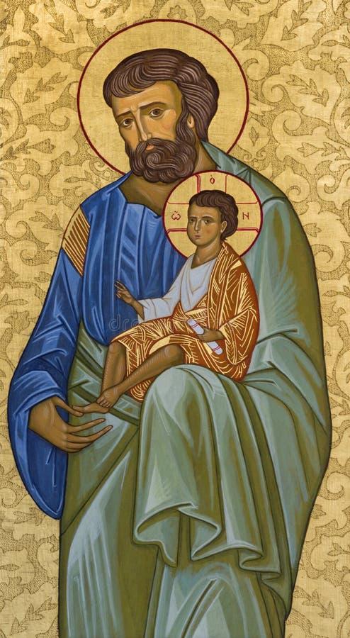MODENA ITALIEN - APRIL 14, 2018: Symbolen av St Joseph i kyrkliga Abbazia di San Pietro av den okända konstnären fotografering för bildbyråer