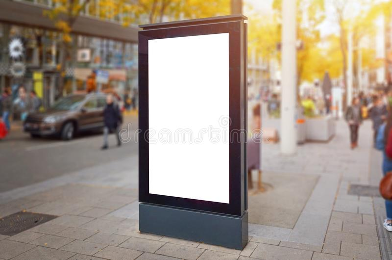 Moder city street vertical billboard mockup. People and cars in background.  royalty free stock photo
