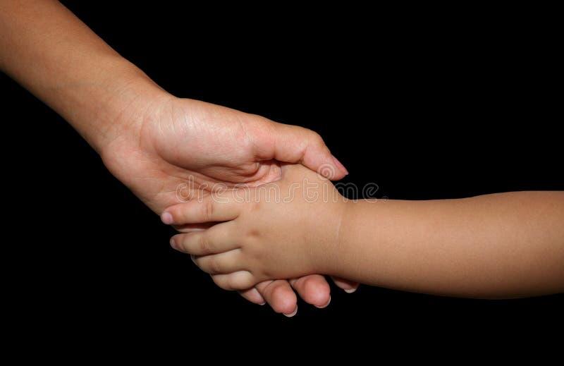 moder för dotterhandholding royaltyfri foto