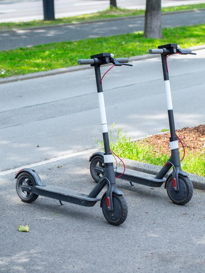 Modern сity transport - Two electric scooters is parked on the street of the city royalty free stock image