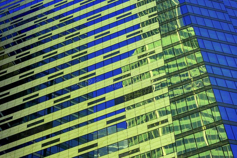 Modern abstract building, geometric pattern of glass and concrete, design with reflection. Urban building background stock photography