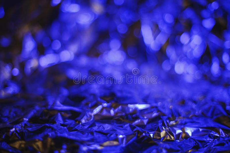 Modern abstract foil background lit by colorful ultraviolet lamp stock photography