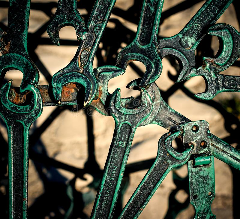 Modern abstract industrial pattern from welded metal spanners. Steampunk background royalty free stock photo