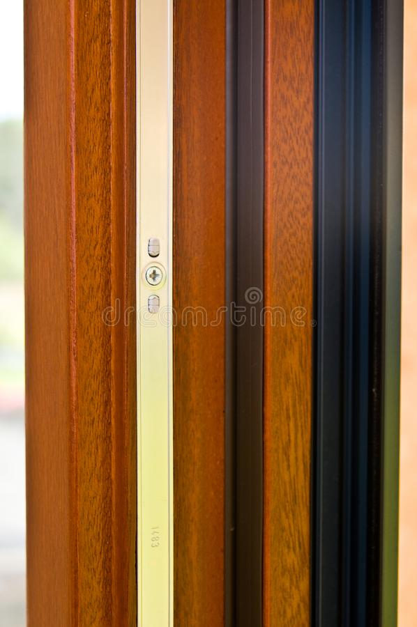Modern advanced window profile made of wood and aluminum stock photos
