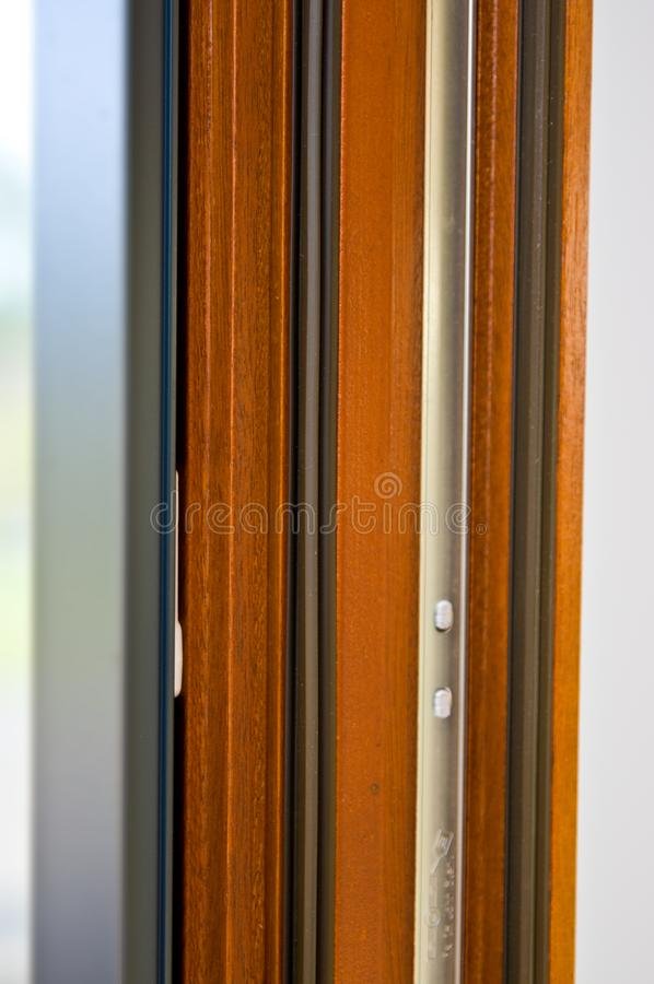 Modern advanced window profile made of wood and aluminum royalty free stock image