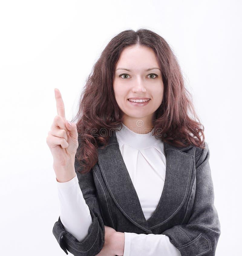 Modern aff?rskvinna som pekar p? kopieringsutrymme arkivfoto