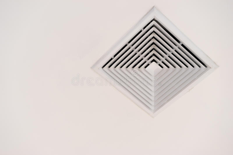 Modern air conditioner or air vent on ceiling with clipping path and copy space.  stock image