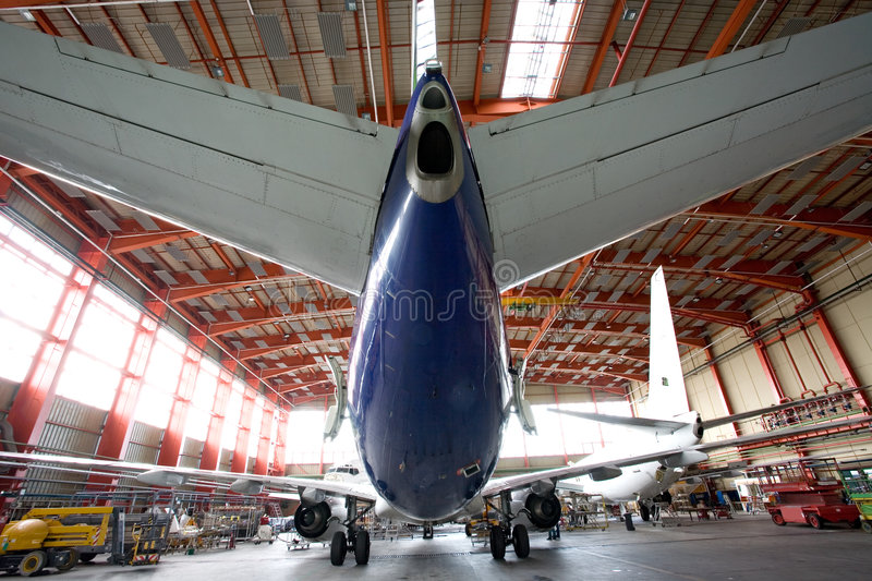 Modern airplane in the hangar stock photo