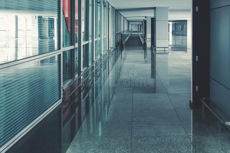 Modern airport hall interior with nobody. empty airport premises without people. straight escalator on the floor.  royalty free stock photo