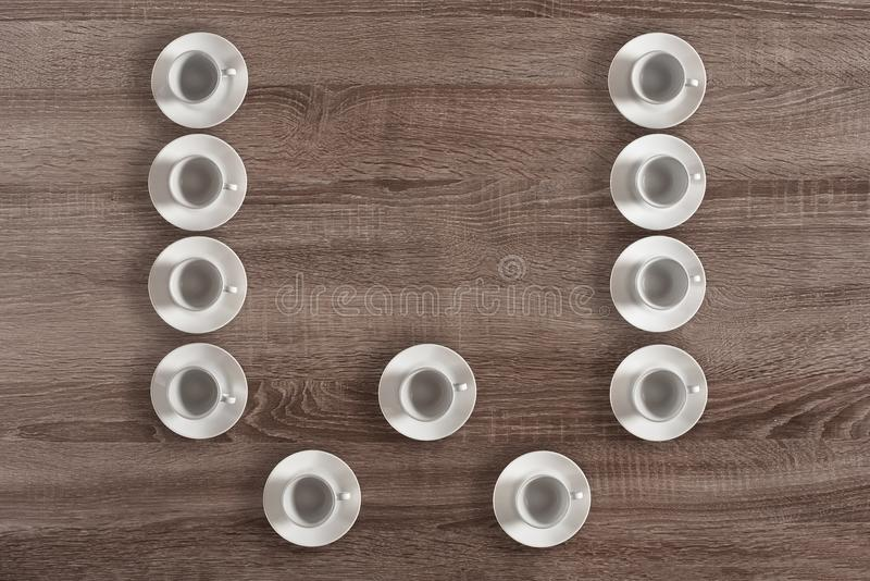 Modern alphabet of cups. Modern alphabet letter W made of white cups royalty free stock images
