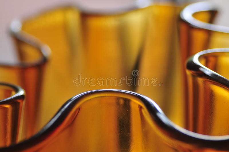 Modern Amber Glass Art Vase Abstract Mood Curves Series Background stock photography