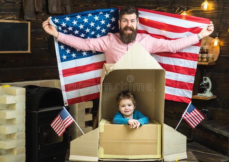 Modern american family with USA flag and paper rocket. stock photo