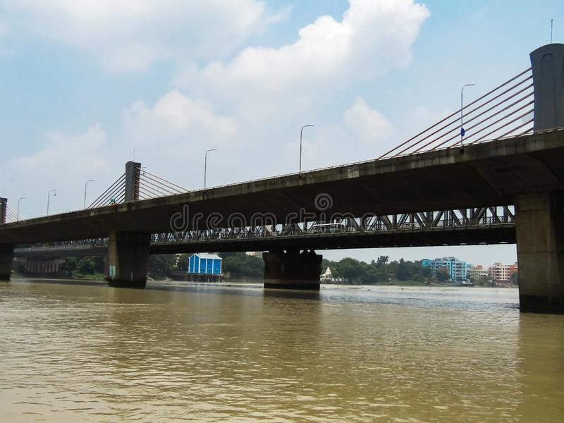 Modern and anciant steel structure in bridge technology.. Form the middle of the river view of cable system bridge in Kolkata, locally called Nibedita Setu stock photography