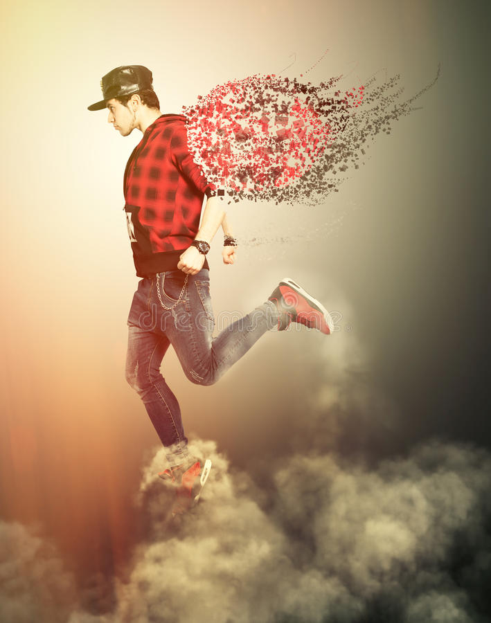 Modern angel boy with wings walking on the clouds. Youth power royalty free stock photos