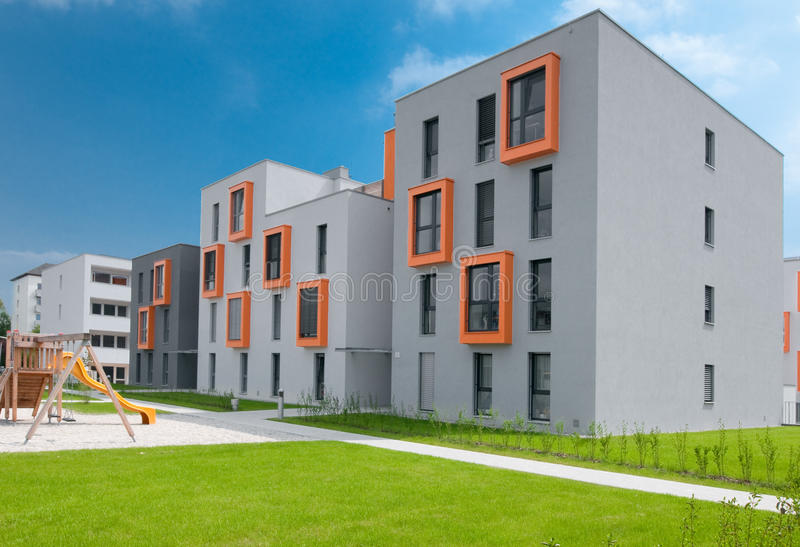 Modern Apartment Block. Colorful modern apartment block with park stock images