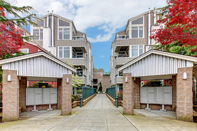 Download Modern Apartment Buildiing With Mail Boxes And Red Maple. Stock Image - Image: 28840809