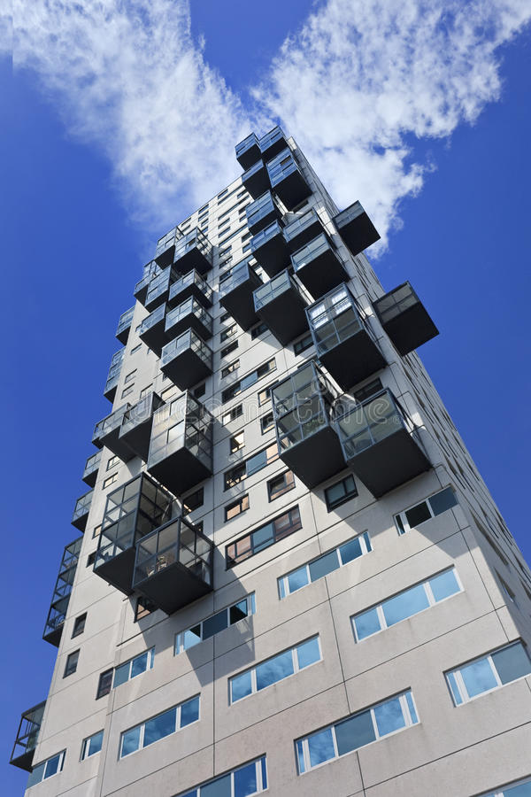 Modern apartment building against blue sky with clouds, Tilburg, Netherlands stock images