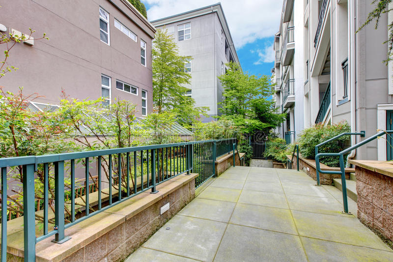 Download Modern Apartment Building With Court Walkway. Stock Photo - Image: 28840816