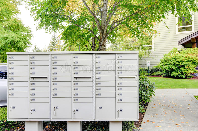 Modern apartment building exterior with mail boxes close up. royalty free stock photo