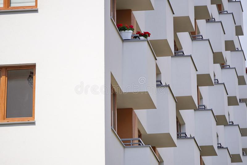 Modern apartment building outside in daytime. balcony in modern house, facade of modern apartment building. strict repeating. Modern apartment building outside royalty free stock photo