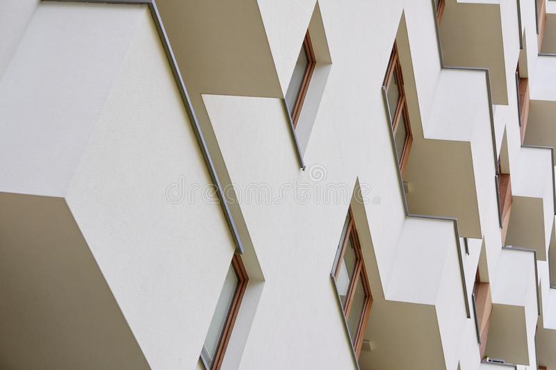 Modern apartment building outside in daytime. balcony in modern house, facade of modern apartment building. strict repeating. Modern apartment building outside royalty free stock photography